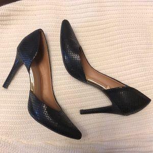 Black closed toe pointed snake skin heels
